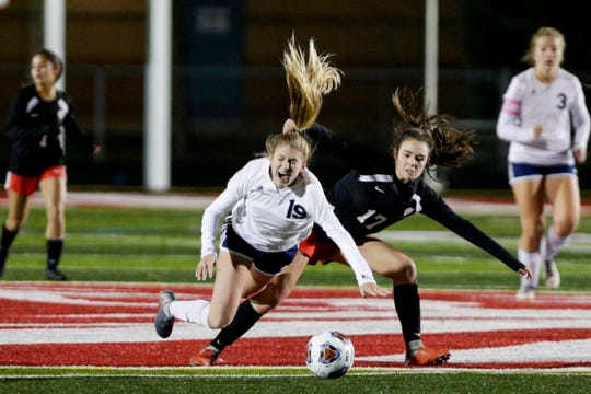 Central Catholic midfielder Caroline Lutz (19) reacts as she collides with Park Tudor midfielder Gracie Whitacre (17) during the second half of the IHSAA class A girls soccer state championship, Friday, Nov. 1, 2019, in Fishers.