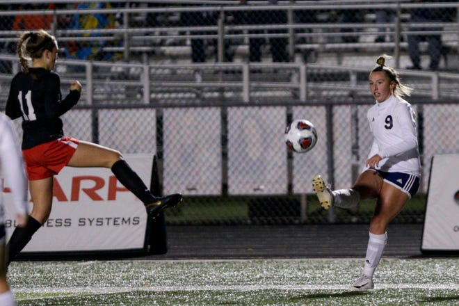 Central Catholic midfielder Hailey Fallen (9) passes the ball during the second half of the IHSAA class A girls soccer state championship, Friday, Nov. 1, 2019, in Fishers.