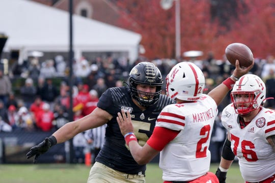 Purdue defensive end George Karlaftis (5) comes in to tackle Nebraska quarterback Adrian Martinez (2) as he throws during the fourth quarter of a NCAA football game, Saturday, Nov. 2, 2019 at Ross-Ade Stadium in West Lafayette.