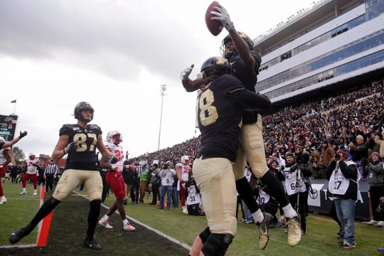 Purdue offensive lineman Grant Hermanns (78) lifts Purdue wide receiver David Bell (3) into the air after Bell scored a touchdown during the fourth quarter of a NCAA football game, Saturday, Nov. 2, 2019 at Ross-Ade Stadium in West Lafayette.