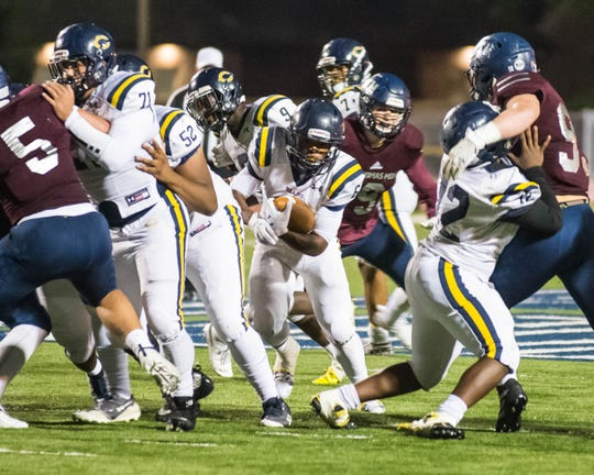 Carencro High running back Dontae Darjean (6) tries to run through a hole in the St. Thomas More defense as the Bears play the Cougars on Friday, Nov. 1, 2019.