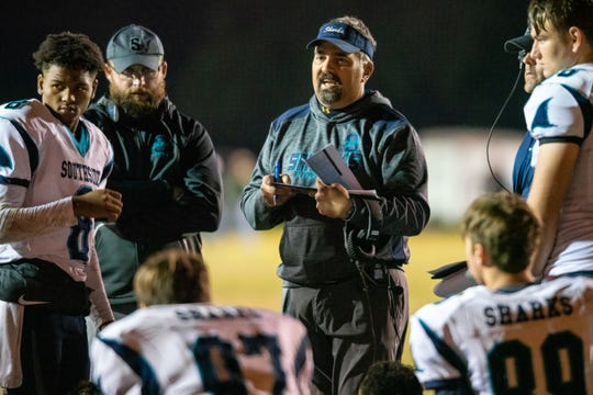 Southside High's head coach Joshua Fontenot talks to his players during halftime as the Comeaux High Spartans take on the Southside High Sharks on Friday, Nov. 1, 2019.