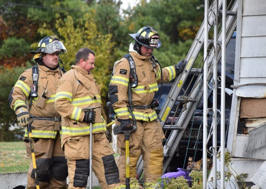 Firefighters continue investigating a house fire after they'd extinguish the flames Nov. 2. A driver called 911 to report the fire around 3 p.m. No one was injured in the fire.