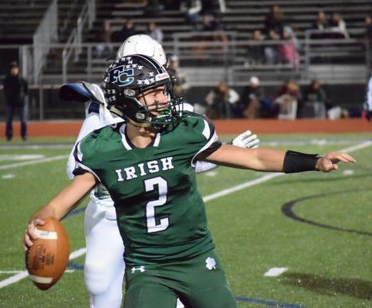 Fisher Catholic senior quarterback Kaden Starcher prepares to throw the ball Friday night against Troy Christian.