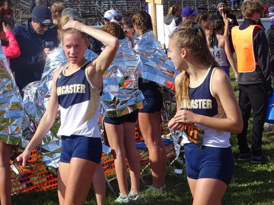 Lancaster's Sarah Craft and Meagan Ward talk in the chute following Saturday's Division I state meet at National Trail Raceway.