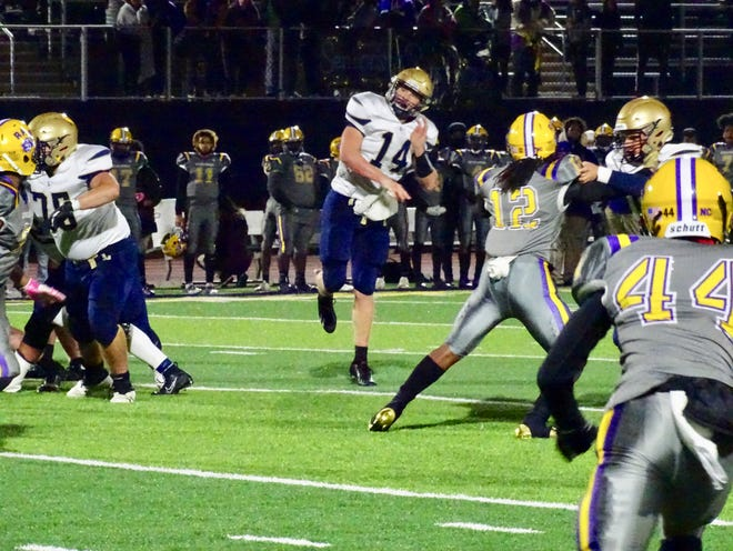 Lancaster senior quarterback Curtis Young throws the ball during the Golden Gales' 55-20 loss Friday night against Reynoldsburg.