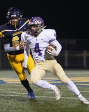 Fowlerville's Kaleb Chappell (4) had a touchdown run, two interceptions and the game-winning 2-point catch in a 29-28 overtime victory over Goodrich on Friday, Nov. 1, 2019.