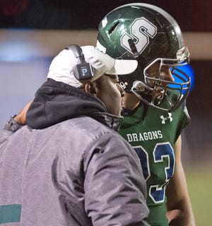 South Oldham head football coach Jamie Reed talks on the sidelines to South Oldham tight end Luke Clark. 01 November 2019