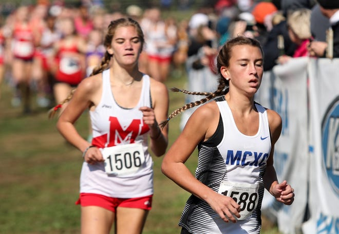 Madison Central's Clara O'Shea is trailed by Dupont Manual's Jessica Secor in the Class 3A State Championship in Cross Country on Nov. 2, 2019.