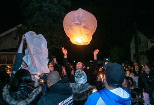 Lanterns being released to end the vigil in honor of the three boys Friday night, Nov. 1, 2019, who died in a house fire earlier this week, Lansing, MI.