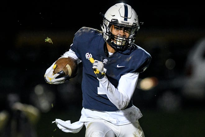 East Lansing's Andrel Anthony Jr. runs after a catch during the fourth quarter on Friday, Nov. 1, 2019, in East Lansing.