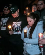 Alyssa Wallace, mother, Juan Zavala, father are surrounded by friends and family as they gather for a candlelight vigil Friday night, Nov. 1, 2019, for the 3 boys who died in a house fire earlier this week, Lansing, MI.
