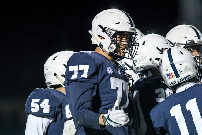 East Lansing's Ethan Boyd signals to a coach on the sideline during the fourth quarter in a game on Nov. 1, 2019, in East Lansing.