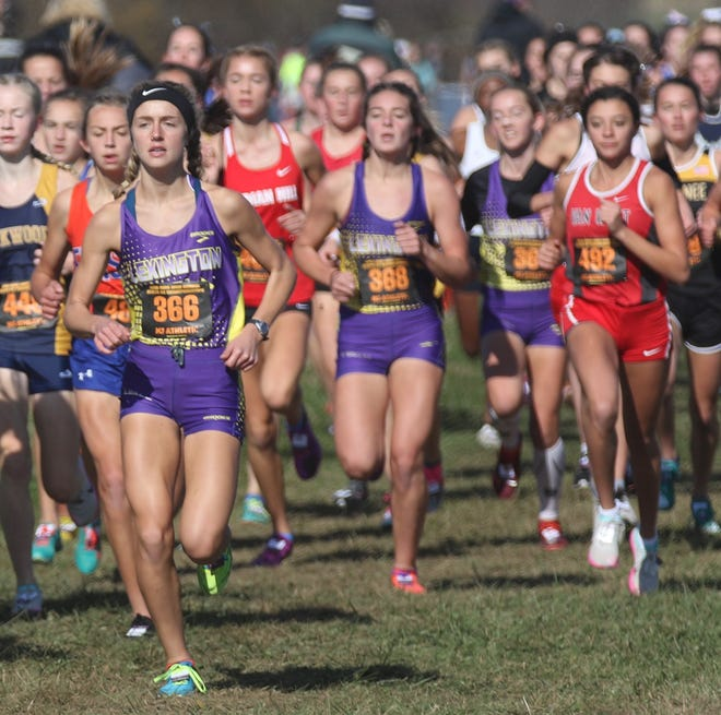 Halle Hamilton (front) and Lily Weeks (back) headline a loaded Lexington girls cross country team that features all five runners who placed on last year's state title team returning for another year.