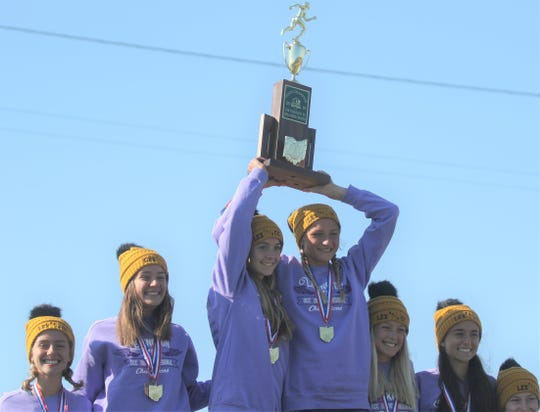 Lexington's Joanna Halfhill (left) and Tessa Gerhardt (right) hoist Lady Lex's third consecutive state title on Saturday.