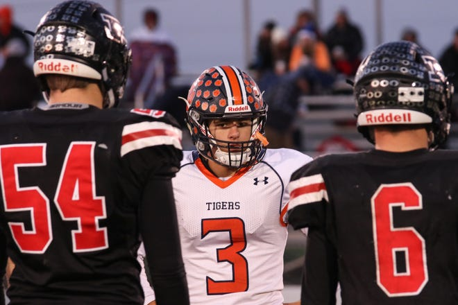 Pleasant's captains meet with Galion before the game on Friday night, a 54-44 win by the Spartans. Pleasant and Northmor both qualified for the football playoffs this season.