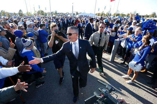 Memphis coach Mike Norvell leads his team as they take the Tiger Walk to the Liberty Bowl before playing SMU on Nov. 2.