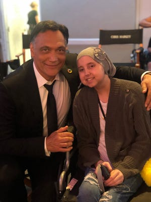 "Actor Jimmy Smits, who plays character Elijah Strait on ""Bluff City Law,"" poses for a photo with Alexis Bezilla."