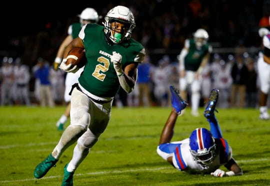 Briarcrest's Jabari Small runs the ball against MUS during their game at Briarcrest Christian on Friday, Nov. 1, 2019.