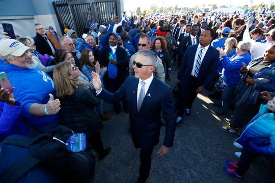University of Memphis Head Coach Mike Norvell leads his team as they take the Tiger Walk to the Liberty Bowl Memorial Stadium before playing SMU Saturday, Nov. 2, 2019.