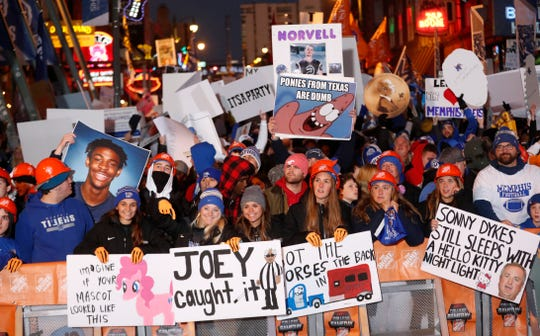 "College football fans lined Beale Street early Saturday morning with their signs for ESPN's ""College GameDay"" which broadcasts live from Memphis on Saturday, Nov. 2, 2019."