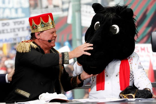 Jerry Lawler reacts as Lee Corso puts the Southern Methodist University mascot head Saturday, Nov. 2, 2019, while filming College GameDay on Beale Street in downtown Memphis.
