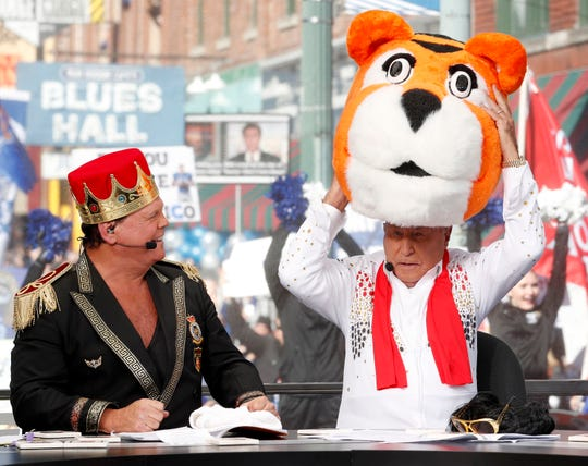 Jerry Lawler reacts as Lee Corso pretends to put on the University of Memphis mascot head Saturday, Nov. 2, 2019, while filming College GameDay on Beale Street in downtown Memphis.