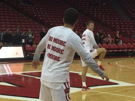 Wisconsin players wear shirts honoring assistant coach Howard Moore before their game against UW-La Crosse on Friday, November 1, 2019, at the Kohl Center in Madison.