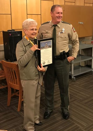 State Rep. Nelda Speaks (left) presented Cpl. Doug Small of the Arkansas Game & Fish Commission with a House citation on Oct. 28 at the Baxter County Republican Committee meeting. Small was selected by state Attorney General Leslie Rutledge as the 2019 Baxter County Law Enforcement Officer of the Year.