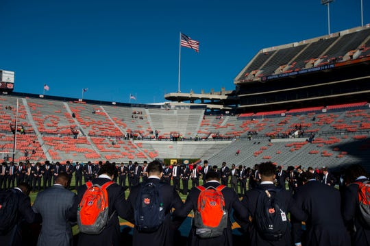 Auburn players pray on the field at Jordan-Hare Stadium in Auburn, Ala., on Saturday, Nov. 2, 2019.