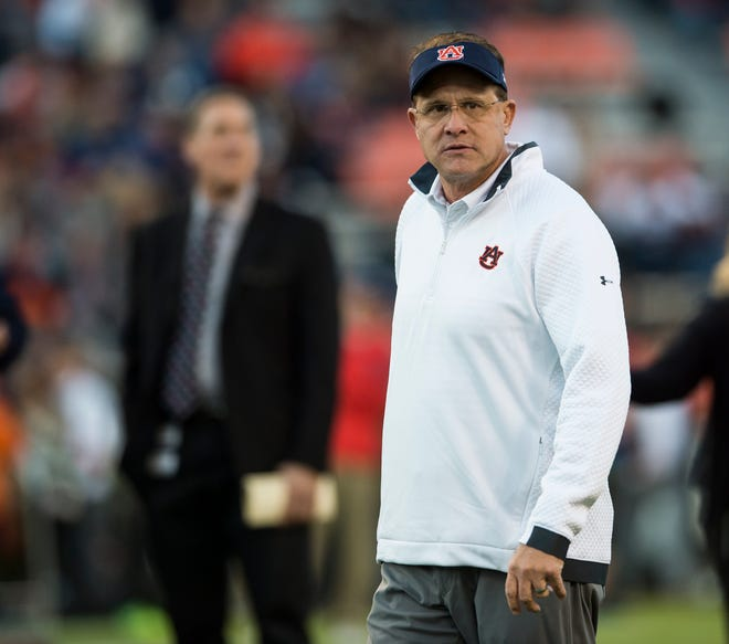 Auburn head coach Gus Malzahn during warm ups before taking on Ole Miss at Jordan-Hare Stadium in Auburn, Ala., on Saturday, Nov. 2, 2019.