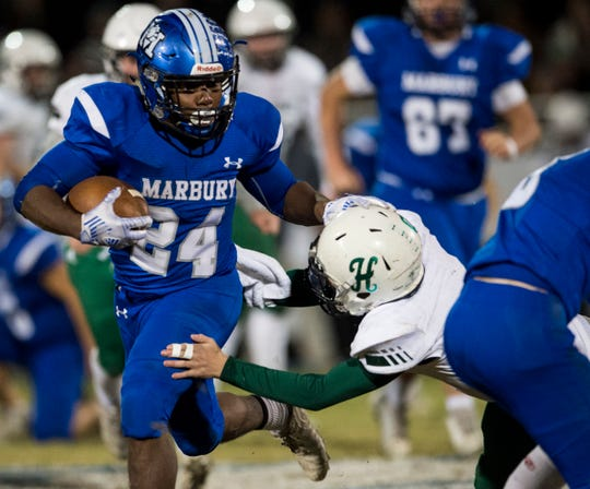 Marbury's Dantavius Bristow (24) runs the ball at Marbury High School in Deatsville, Ala., on Friday, Nov. 1, 2019. Marbury defeated Holtville 36-14.