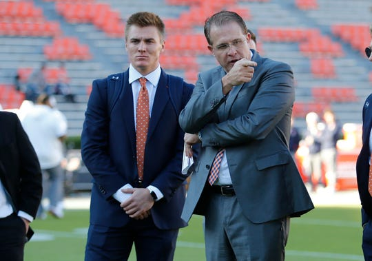 Nov 2, 2019; Auburn, AL, USA;  Auburn Tigers quarterback Bo Nix and head coach Gus Malzahn go through play plans before the game between the Mississippi Rebels and the Auburn Tigers at Jordan-Hare Stadium. Mandatory Credit: John Reed-USA TODAY Sports
