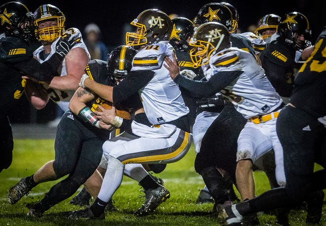 FILE -- Monroe Central faces off against South Adams during the sectional  South Adams High School Friday, Nov. 1, 2019.