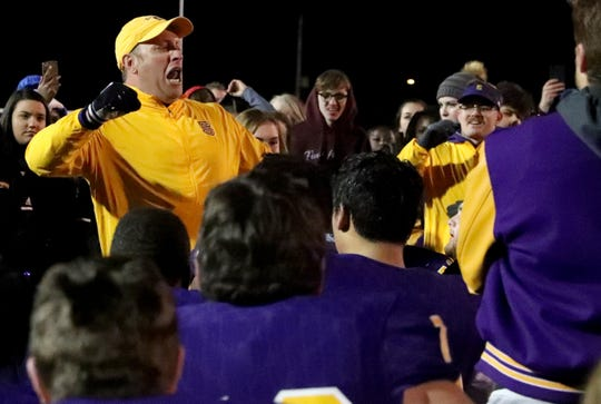 Smyrna's head coach Matt Williams cheers after talking with his team after beating Stewarts Creek on Friday, Nov. 1, 2019 at Smyrna.