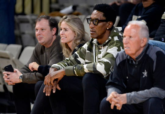 Former Chicago Bulls player Scottie Pippen watches his son guard Scotty Pippen Jr. warm up before an NCAA college basketball game against Clark Atlanta Friday, Nov. 1, 2019, in Nashville, Tenn.