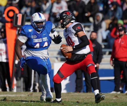 Tennessee State defensive tackle Tarray Jones (44) pursues Southeast Missouri quarterback Daniel Santacaterina during Saturday's game at Hale Stadium.