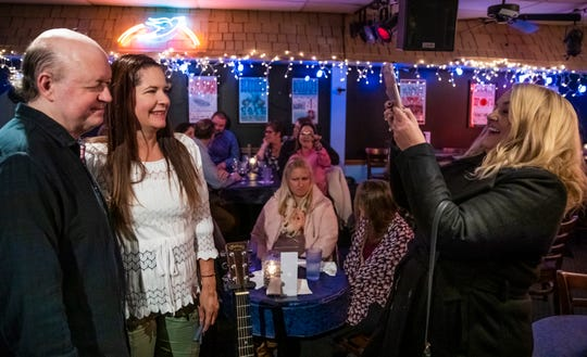 Donna Augustine, far right, takes a photo of Jelly Roll Johnson and her friend Darlene Lewis after his performance at the Bluebird Cafe Friday November 1, 2019.