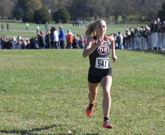 Dobyns- Bennett runner Sasha Neglia finishes first at the TSSAA division 1 cross country state meet at Percy Warner Park in Nashville on Saturday, Nov. 2, 2019.