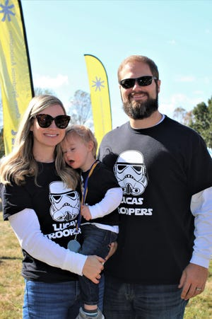 Katie and Duncan Williams with their 2-year-old son Lucas at the 2019 Nashville Buddy Walk, hosted by the Down Syndrome Association of Middle Tennessee .