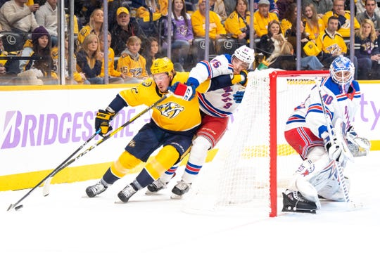 Nashville Predators center Ryan Johansen (92) takes the puck around New York Rangers goaltender Alexandar Georgiev (40) with pressure from New York Rangers defenseman Ryan Lindgren (55) during the first period at Bridgestone Arena Saturday, Nov. 2, 2019 in Nashville, Tenn.