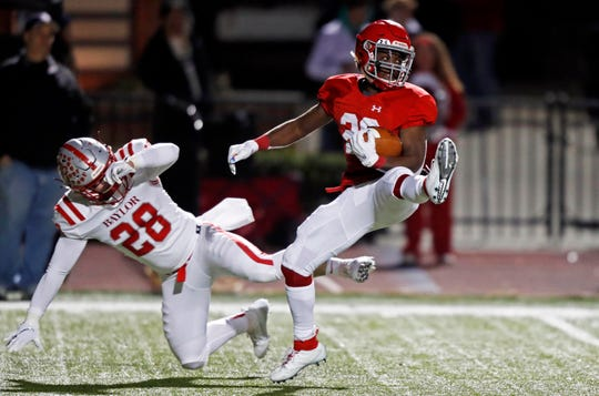 Brentwood Academy's Manny Scott (26) spins away from Baylor's Thomas Latimer (28) during their game Friday, Nov. 1, 2019, in Nashville, Tennessee.