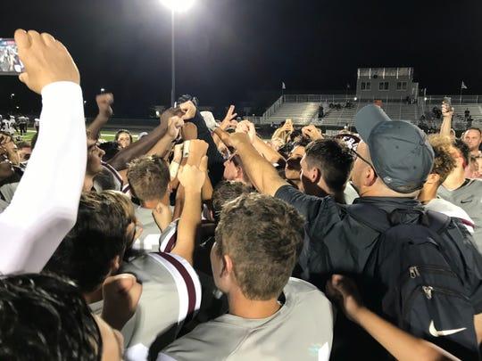 First Baptist Academy celebrates a 10-0 regular season following a 42-0 victory over Orlando-West Oaks Academy on Friday, Nov. 1, 2019.