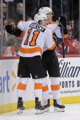 Philadelphia Flyers' Oskar Lindblom, right, celebrates his goal with Travis Konecny during the first period of the team's NHL hockey game against the New Jersey Devils in Newark, N.J., Friday, Nov. 1, 2019.
