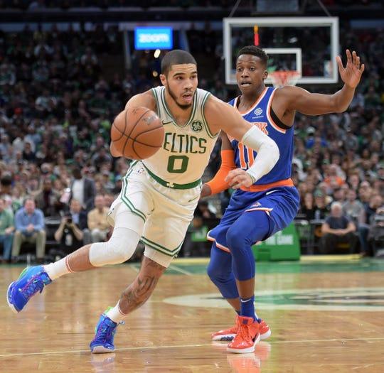 Nov 1, 2019; Boston, MA, USA; Boston Celtics forward Jayson Tatum (0) drives to the basket past New York Knicks guard Frank Ntilikina (11) during the second half at TD Garden.