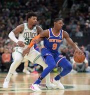 Nov 1, 2019; Boston, MA, USA; Boston Celtics guard Marcus Smart (36) guards New York Knicks forward RJ Barrett (9) during the second half at TD Garden.