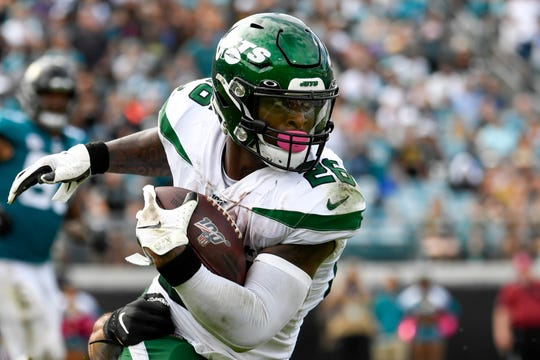 Oct 27, 2019; Jacksonville, FL, USA; New York Jets running back Le'Veon Bell (26) runs the ball during the fourth quarter against the Jacksonville Jaguars at TIAA Bank Field.