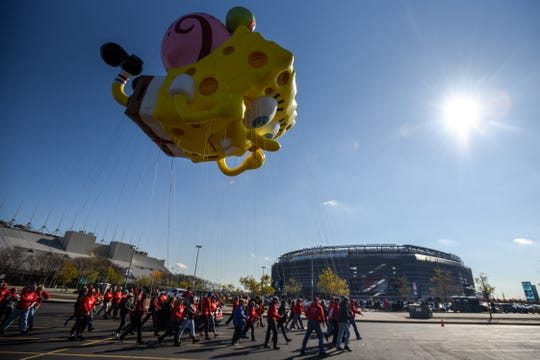 Macy's tests the new Thanksgiving Parade balloons in East Rutherford on Saturday November 2, 2019. A Spongebob Squarepants and Gary balloon flies in front of Metlife Stadium.