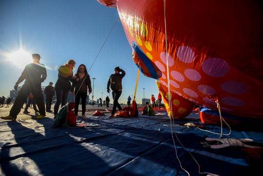Macy's tests the new Thanksgiving Parade balloons in East Rutherford on Saturday November 2, 2019. A crew works on the Love Flies Up to the Sky balloon designed by artist Yayoi Kusama.