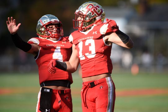 DePaul football at Bergen Catholic on Saturday, November 2, 2019. BC #13 Joseph Aniello celebrates with QB Andrew Boel after scoring a touchdown in the first quarter.